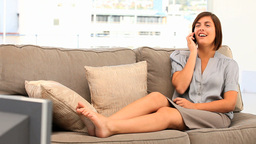 Cute brunette woman talking on the phone Footage