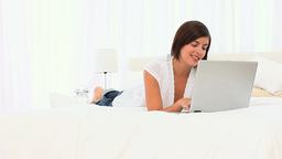Cute brownhaired woman using her laptop Stock Video Footage