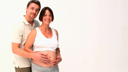 Man stroking the belly of his pregnant woman Stock Video Footage