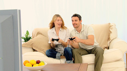 Pretty couple playing a video game Stock Video Footage