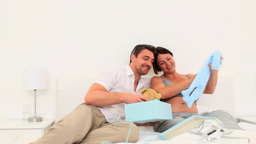Pretty couple opening gifts Footage
