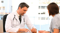 Doctor giving a prescription to his patient Footage