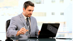 Darkhaired businessman working on his laptop Footage