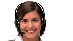 Brunette businesswoman speaking over the headset Footage