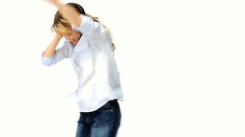 Blonde girl dancing with headpones Stock Video Footage