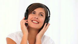 Gorgeous lady listening to music with headphones Footage