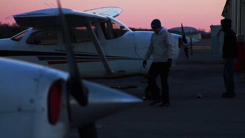 Airplane at Sunset, Man is Parking it Stock Video Footage