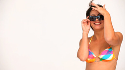 Wonderful brunette in swimsuit with sunglasses Footage
