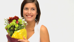 Wonderful brunette holding a bunch of flowers Stock Video Footage