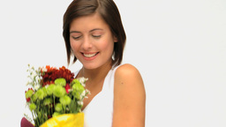 Wonderful Brunette Holding A Bunch Of Flowers stock footage