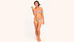 Brunette in swimsuit eating an apple Stock Video Footage