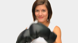 Brownhaired woman with boxing gloves Footage