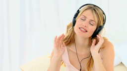 Blonde lady enjoying music Footage