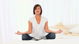 Brownhaired woman doing yoga Footage
