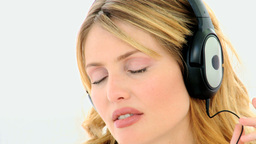 Attractive blonde woman listening to music Footage
