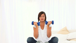 Pretty brunette with dumbbells Stock Video Footage
