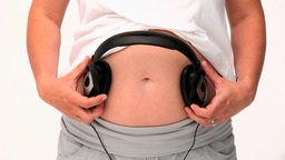 Pregnant woman letting her future baby listening t Footage