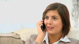 Cute brunette speaking on the phone Footage