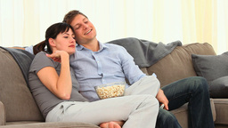 Young couple watching tv Stock Video Footage