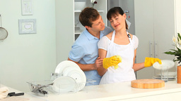 Couple washing dishes Stock Video Footage
