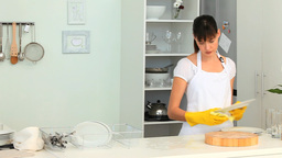 Brunette woman washing dishes Footage