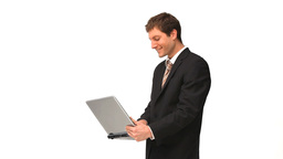 Businessman standing up with a laptop Stock Video Footage