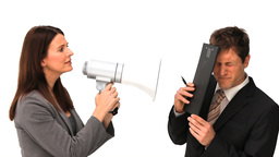 Businesswoman giving orders through a megaphone Footage