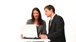 Business people speaking in front of a laptop Footage