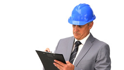 Businessman working on a building project Footage