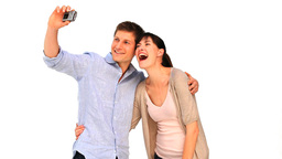 Cute couple taking a picture of themself Footage