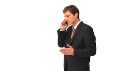 Young businessman in suit speaking on the phone Stock Video Footage
