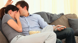Couple watching a scary movie Footage