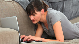 Attractive woman chatting on her laptop Stock Video Footage