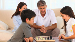 Children and parents playing chess Footage