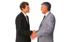 Two businessmen shaking hands Footage