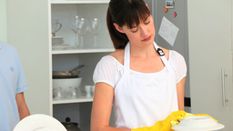 Brunette woman doing the dishes Stock Video Footage