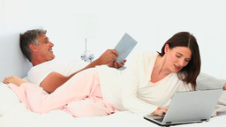 Couple with book and laptop Stock Video Footage