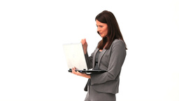 Business woman standing with a laptop Stock Video Footage