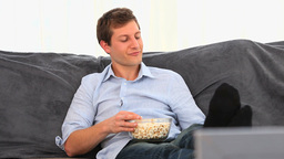 Casual man eating popcorn Footage
