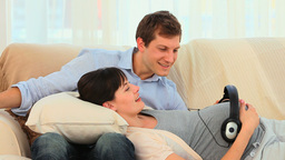 Young couple letting their future baby listening t Stock Video Footage