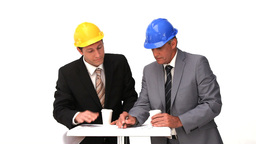 Two architects with safety helmets speaking Stock Video Footage