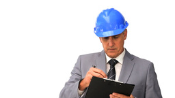 Businessman with safety helmet taking notes Footage