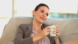Brunette middle aged lady drinking a cup of coffee Footage