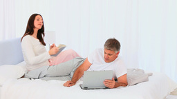 Middle aged couple looking at a laptop Footage