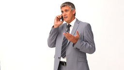 Man in suit getting nervous on the phone Stock Video Footage