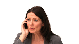 Business woman getting nervous on the phone Stock Video Footage