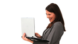 Business woman standing up with a laptop Footage