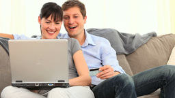 Couple paying something with internet Footage