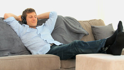 Relaxed man listening to music Footage