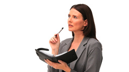 Business woman looking at her diary Footage